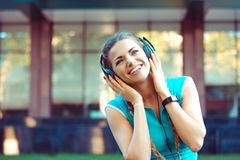 Athletic woman enjoying music in headphones stock images