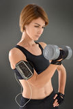 Athletic woman excercising with dumbbells Royalty Free Stock Image
