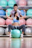 Athletic woman exercises in fitness gym royalty free stock images