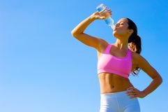 Athletic Woman Exercising Stock Images