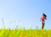 Athletic Woman Exercising Stock Photo
