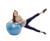 Athletic woman exercising with the ball Stock Image