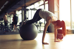 Athletic woman exercising in gym Royalty Free Stock Photo
