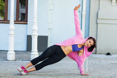 Athletic woman exercising side plank Royalty Free Stock Photos