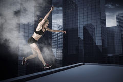 Composite image of athletic woman exercising on white background Royalty Free Stock Image