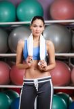 Athletic woman in fitness gym Royalty Free Stock Images