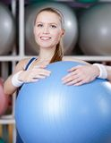 Athletic woman with gym ball Royalty Free Stock Photo