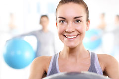 Athletic woman in the gym Stock Photography