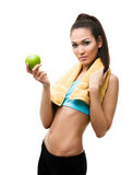 Athletic woman hands green apple Royalty Free Stock Image