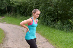 Athletic Woman Having a Back Pain While Exercising stock photos