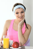 Athletic woman having breakfast Stock Photo