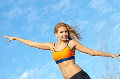 Athletic woman with her arms Stock Photography