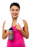 Athletic woman holding sipper bottle Stock Image