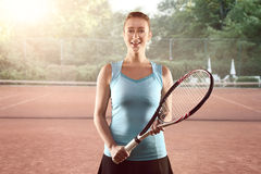 Athletic Woman Holding Tennis Racket tennis court Stock Photos