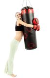 Athletic woman hugging a punching bag Royalty Free Stock Photography