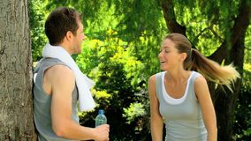 Athletic woman joining boyfriend after a jog Royalty Free Stock Photo
