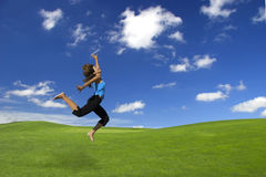 Athletic woman jumping stock photo