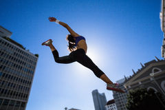 Athletic woman jumping in the air Royalty Free Stock Photos