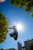 Athletic woman jumping in the air Royalty Free Stock Image