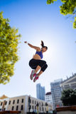 Athletic woman jumping in the air Royalty Free Stock Images