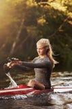 Athletic woman kayaking Royalty Free Stock Photos