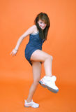 Athletic Woman Kick. Athletic young woman raising leg to kick in profile Stock Photography