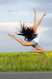 Athletic woman leaping in ballet pose Stock Images