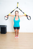Athletic woman makes exercise Royalty Free Stock Photo