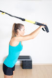 Athletic woman makes exercise Royalty Free Stock Photos