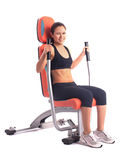 Athletic woman on modern gym trainer Royalty Free Stock Image