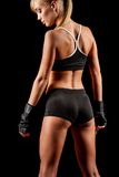 Athletic woman over dark background Stock Images
