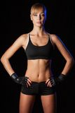 Athletic woman over dark background Stock Photo