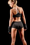 Athletic woman over dark background Royalty Free Stock Photo