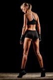 Athletic woman over dark background Royalty Free Stock Image