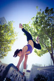 Athletic woman performing handstand on bar Royalty Free Stock Image