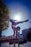 Athletic woman performing handstand on bench Royalty Free Stock Photos