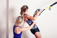 Athletic woman and personal trainer Stock Photography