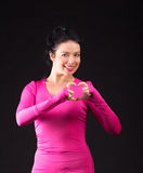 Athletic woman in pink on black Royalty Free Stock Images