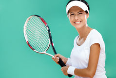 Athletic woman plays tennis Royalty Free Stock Image
