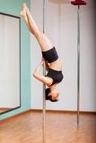 Athletic woman pole dancing Royalty Free Stock Image