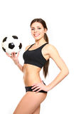 Athletic woman posing with a soccer ball on a white background Royalty Free Stock Photos