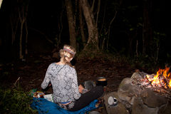 Athletic Woman Preparing a Camping Meal Royalty Free Stock Image