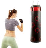 Athletic woman preparing to hit the punching bag Stock Photo