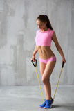 Athletic woman with resistance bands Royalty Free Stock Images