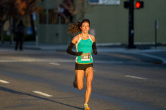 Athletic woman running fast during the morning royalty free stock image