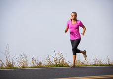 Athletic woman running jogging outside Royalty Free Stock Images