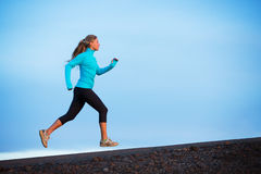 Athletic woman running jogging outside Royalty Free Stock Photos