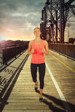 Athletic woman running outdoor. Sunrise in background Royalty Free Stock Photo