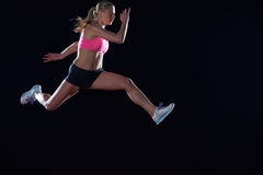 Athletic woman running on track Royalty Free Stock Photography
