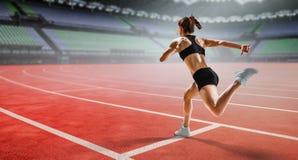 Sportswoman running race. Mixed media stock images